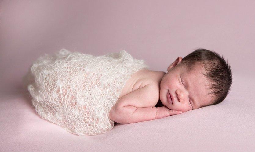 newborn baby smiles